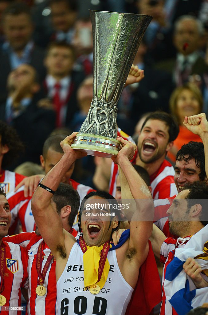Radamel Falcao of Atletico Madrid holds the trophy aloft with his team mates at the end of the UEFA Europa League Final between Atletico Madrid and Athletic Bilbao at the National Arena on May 9, 2012 in Bucharest, Romania.