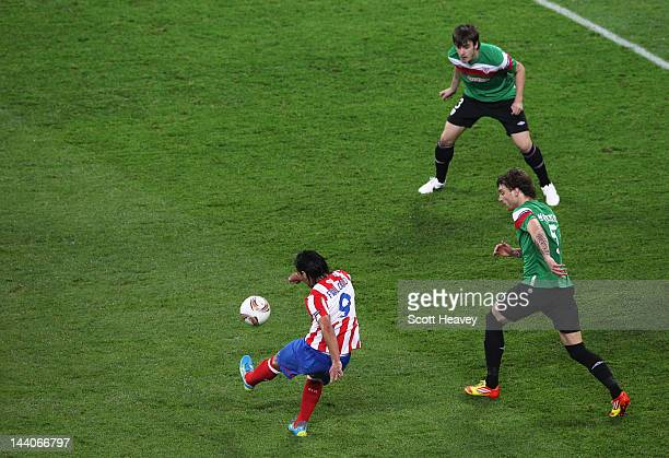 Radamel Falcao of Atletico Madrid scores the opening goal during the UEFA Europa League Final between Atletico Madrid and Athletic Bilbao at the...