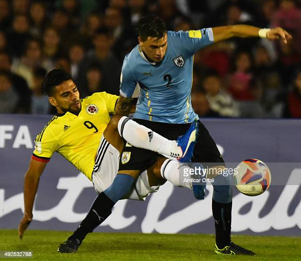 Radamel Falcao of Colombia and José Giménez of Uruguay struggle for the ball during a match between Uruguay and Colombia as part of FIFA 2018 World...