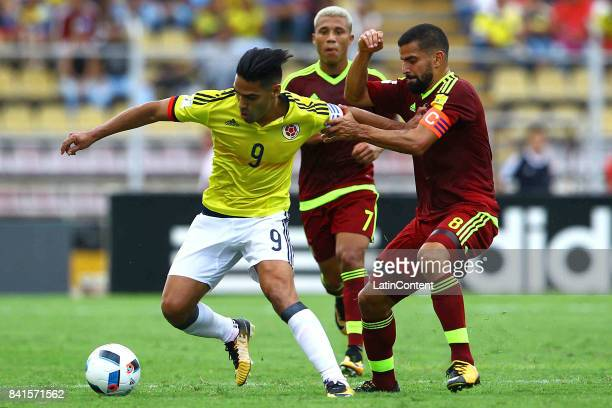 Radamel Falcao of Colombia and Tomas Rincon of Venezuela fight for the ball during a match between Venezuela and Colombia as part of FIFA 2018 World...