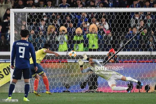 Radamel Falcao of Colombia beats Masaaki Higashiguchi of Japan from penalty spot during the international friendly match between Japan and Colombia...