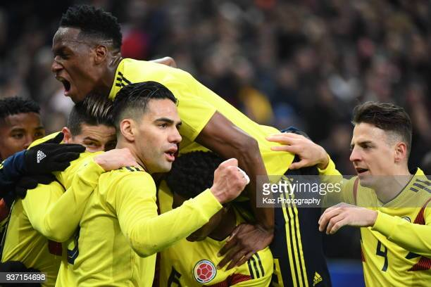 Radamel Falcao of Colombia celebraes his equaliser with his team mates James Rodoriguez Luis Fernando Muriel and Santiago Arias of Colombia at Stade...