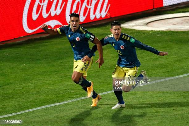 Radamel Falcao of Colombia celebrates after scoring the the second goal of his team with teammate James Rodríguez during a match between Chile and...