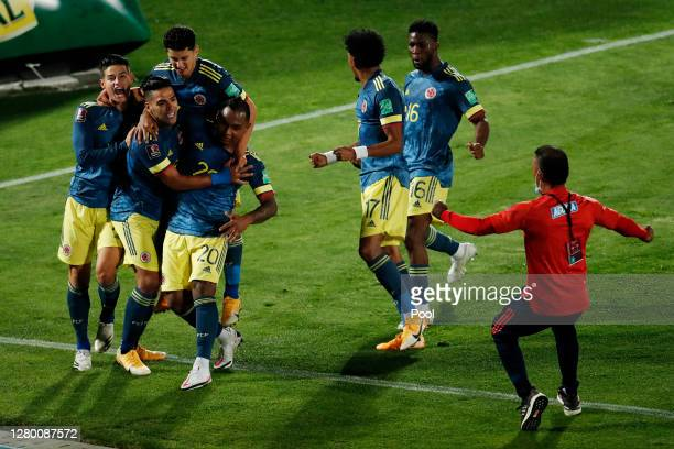 Radamel Falcao of Colombia celebrates after scoring the the second goal of his team with teammates during a match between Chile and Colombia as part...