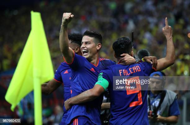 Radamel Falcao of Colombia celebrates with teammate James Rodriguez after scoring his team's second goal during the 2018 FIFA World Cup Russia group...