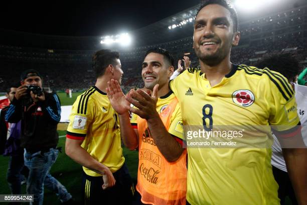 Radamel Falcao of Colombia celebrates with teammates Abel Aguilar and James Rodriguez celebrate the qualifying to the World Cup Russia 2018 after the...