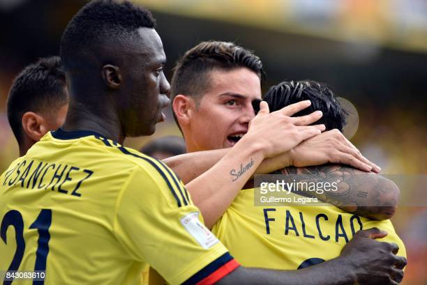Radamel Falcao of Colombia celebrates with with James Rodriguez after scoring the equalizer during a match between Colombia and Brazil as part of...