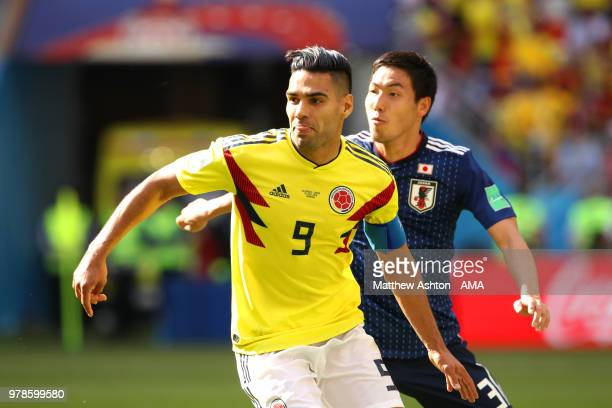 Radamel Falcao of Colombia competes with Gen Shoji of Japan during the 2018 FIFA World Cup Russia group H match between Colombia and Japan at...