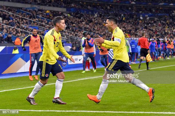 Radamel Falcao of Colombia is congratulated by teammate James Rodriguez after scoring during the international friendly match between France and...