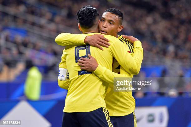 Radamel Falcao of Colombia is congratulated by teammate Luis Fernando Muriel after scoring during the international friendly match between France and...