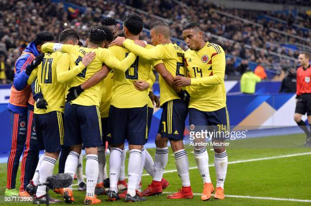 Radamel Falcao of Colombia is congratulated by teammates after scoring during the international friendly match between France and Colombia at Stade...