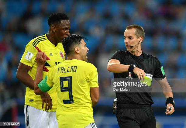 Radamel Falcao of Colombia is shown a yellow card by referee Mark Geiger during the 2018 FIFA World Cup Russia Round of 16 match between Colombia and...