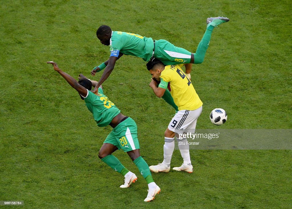 Radamel Falcao of Colombia is tackled by Cheikhou Kouyate and Keita Balde of Senegal during the 2018 FIFA World Cup Russia group H match between Senegal and Colombia at Samara Arena on June 28, 2018 in Samara, Russia.
