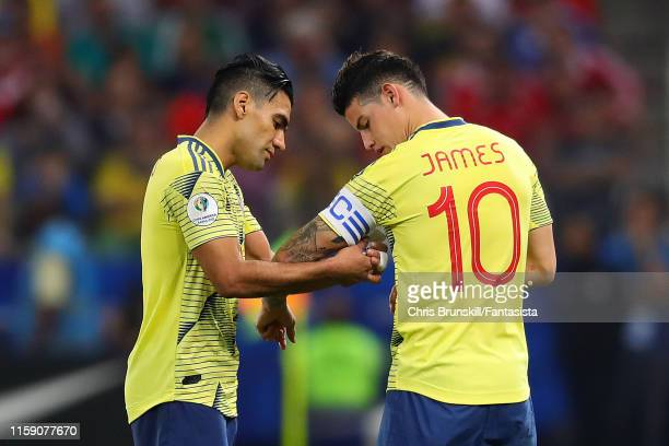 Radamel Falcao of Colombia passes the captain's armband to team-mate James Rodriguez during the Copa America Brazil 2019 quarterfinal match between...