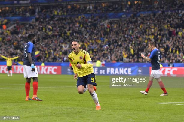 Radamel Falcao of Colombia reacts after scoring during the international friendly match between France and Colombia at Stade de France on March 23...