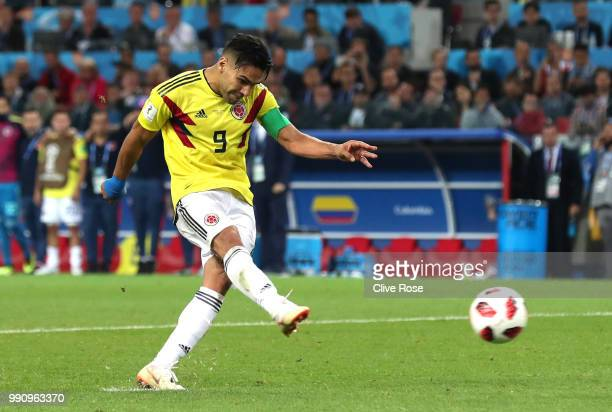 Radamel Falcao of Colombia scores his team's first penalty in the penalty shoot out during the 2018 FIFA World Cup Russia Round of 16 match between...