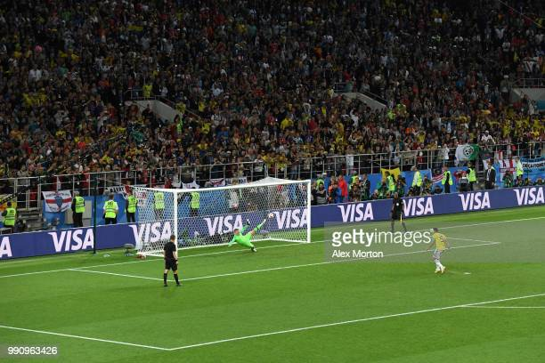 Radamel Falcao of Colombia scores his team's first penalty pats Jordan Pickford of England in the penalty shoot out during the 2018 FIFA World Cup...