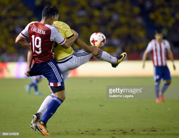 Radamel Falcao of Colombia struggles for the ball with Fabian Balbuena of Paraguay during a match between Colombia and Paraguay as part of FIFA 2018...