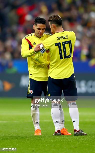 Radamel Falcao of Columbia hands over the Captains arm band to James Rodriguez during the International friendly match between France and Columbia at...