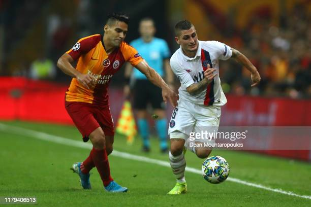 Radamel Falcao of Galatasaray battles for the ball with Marco Verratti of PSG during the UEFA Champions League group A match between Galatasaray and...