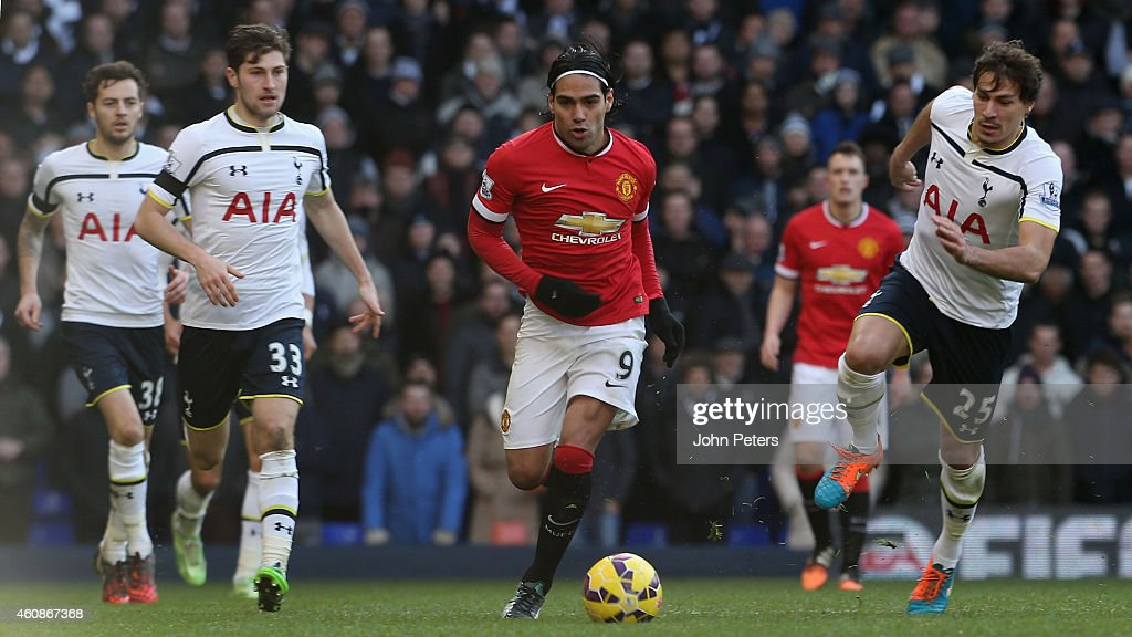 Radamel Falcao of Manchester United in action with Ben Davies and Benjamin Stambouli of Tottenham Hotspur during the Barclays Premier League match between Tottenham Hotspur and Manchester United at White Hart Lane on December 28, 2014 in London, England.