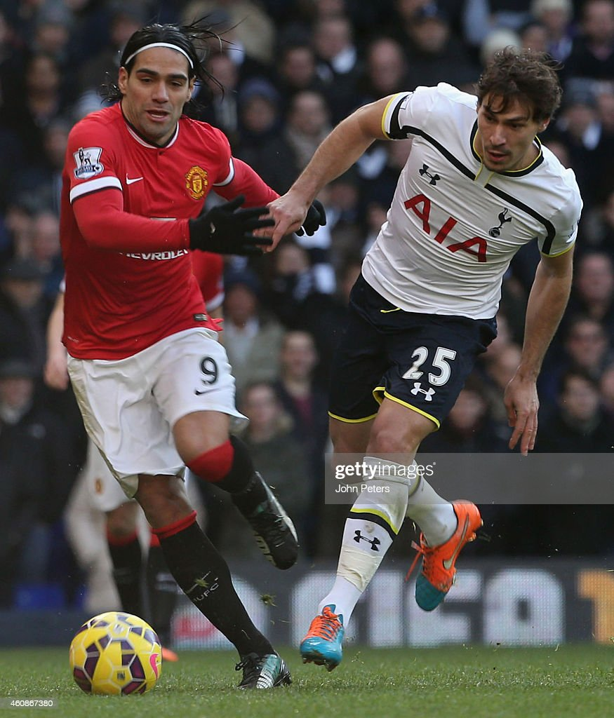 Radamel Falcao of Manchester United in action with Benjamin Stambouli of Tottenham Hotspur during the Barclays Premier League match between Tottenham Hotspur and Manchester United at White Hart Lane on December 28, 2014 in London, England.