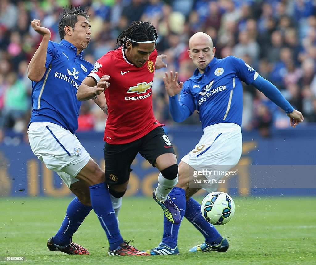 Radamel Falcao of Manchester United in action with Leonardo Ulloa and Esteban Cambiasso of Leicester City during the Barclays Premier League match between Leicester City and Manchester United at The King Power Stadium on September 21, 2014 in Leicester, England.