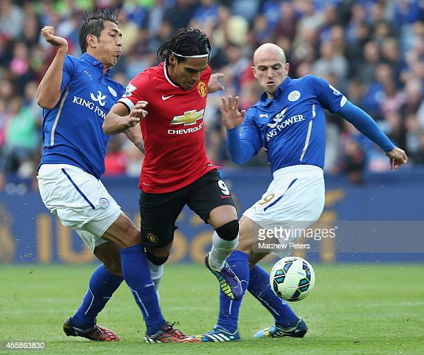 Radamel Falcao of Manchester United in action with Leonardo Ulloa and Esteban Cambiasso of Leicester City during the Barclays Premier League match...