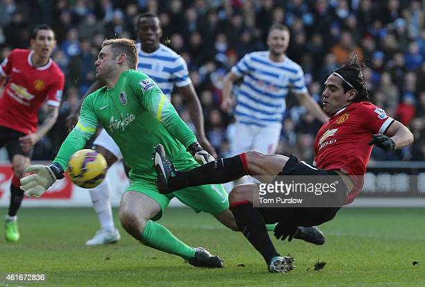 Radamel Falcao of Manchester United in action with Robert Green of Queens Park Rangers during the Barclays Premier League match between Queens Park...