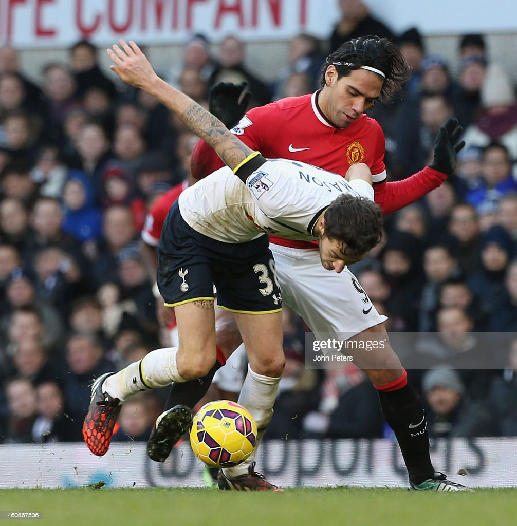 Radamel Falcao of Manchester United in action with Ryan Mason of Tottenham Hotspur during the Barclays Premier League match between Tottenham Hotspur and Manchester United at White Hart Lane on December 28, 2014 in London, England.