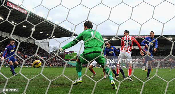 Radamel Falcao of Manchester United scores his team's first goal during the Barclays Premier League match between Stoke City and Manchester United at...