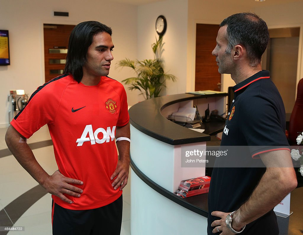 (EDITORS: Image has been digitally altered) Radamel Falcao of Manchester United talks with Assistant Manager Ryan Giggs after signing for the club on loan on September 1, 2014 in Manchester, England.