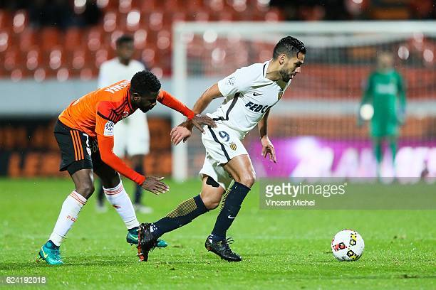 Radamel Falcao of Monaco and Arnold Mvuemba of Lorient during the Ligue 1 match between Fc Lorient and As Monaco at Stade du Moustoir on November 18...