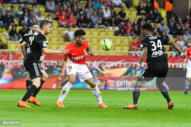 Radamel Falcao of Monaco and Bongani Zungu and Oualid El Hajjam of Amiens during the Ligue 1 match between AS Monaco and Amiens SC at Stade Louis II...