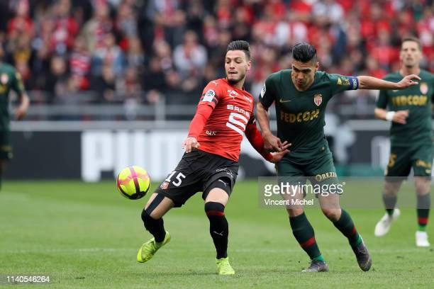 Radamel Falcao of Monaco and Ramy BENSEBAINI of Rennes during the Ligue 1 match between Rennes and Monaco on May 1 2019 in Rennes France