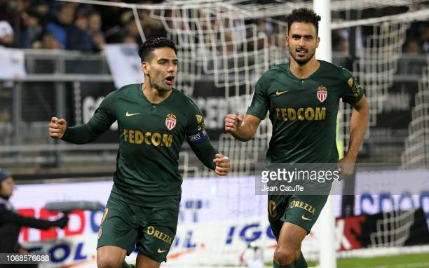 Radamel Falcao of Monaco celebrates his first goal on a penalty kick with Nacer Chadli during the Ligue 1 match between Amiens SC and AS Monaco at...