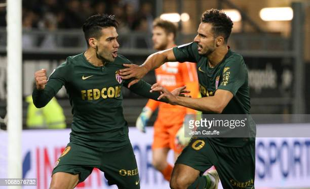 Radamel Falcao of Monaco celebrates his first goal on a penalty kick with Nacer Chadli while goalkeeper of Amiens Regis Gurtner looks on during the...