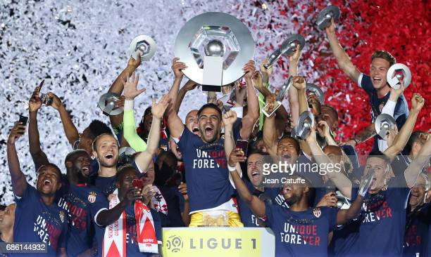 Radamel Falcao of Monaco holds the trophy during the French League 1 Championship title celebration following the French Ligue 1 match between AS...