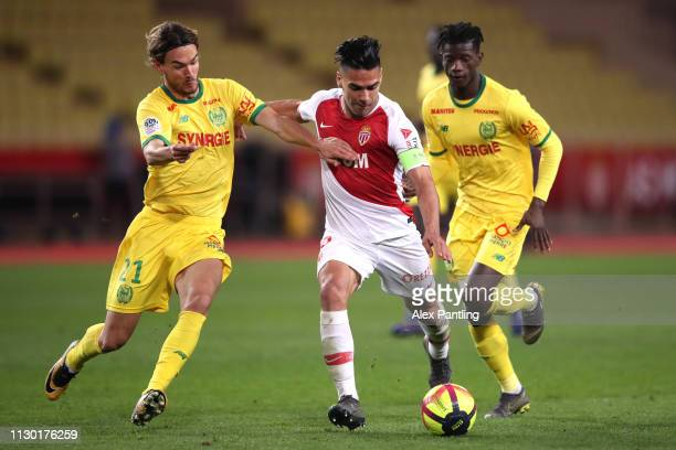 Radamel Falcao of Monaco shoots under pressure from Rene Krhin of Nantes during the Ligue 1 match between AS Monaco and FC Nantes at Stade Louis II...