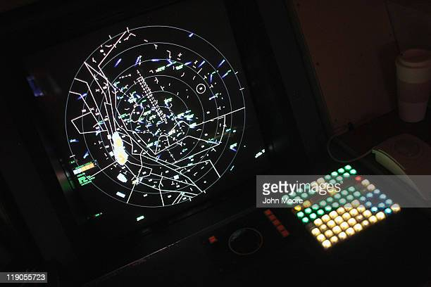 A radar screen tracks incoming and outgoing flights for air traffic controllers at the Terminal Radar Approach Control center on July 14 2011 at the...