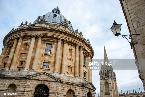 radcliffe camera and university church of st mary the virgin, oxford, england, uk - oxford university stock pictures, royalty-free photos & images
