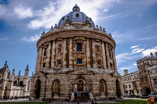 Radcliffe Camera of University of Oxford dome and rotunda exterior under cloudy sky, England, UK - gettyimageskorea