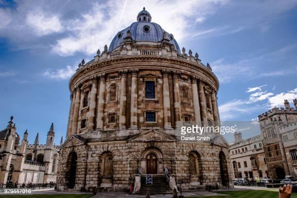 Radcliffe Camera of University of Oxford dome and rotunda exterior under cloudy sky, England, UK