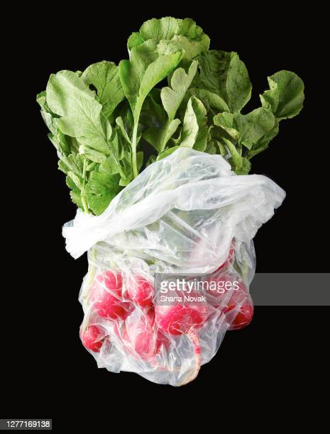 "raddish bunch in plastic produce bag - ""shana novak"" stock pictures, royalty-free photos & images"