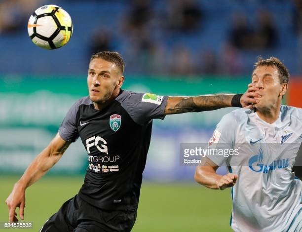 Rade Dugalic of FC Tosno and Artyom Dzyuba of FC Zenit Saint Petersburg vie for the ball during the Russian Football League match between FC Tosno...