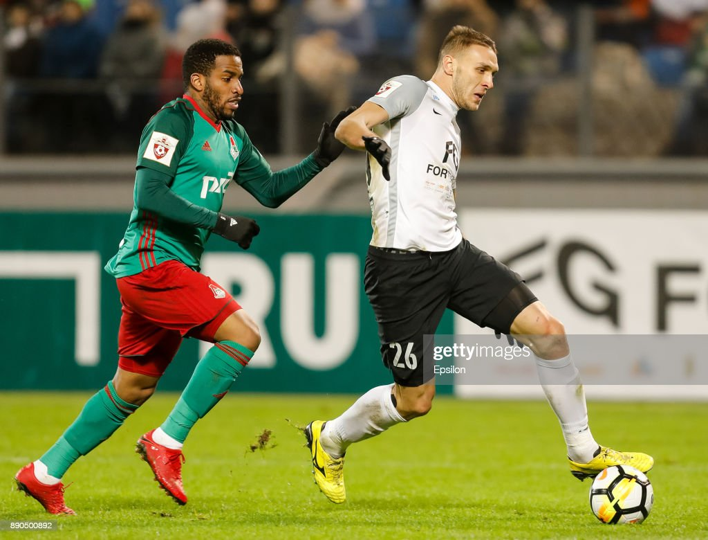 Rade Dugalic (R) of FC Tosno and Jefferson Farfan of FC Lokomotiv Moscow vie for the ball during the Russian Football League match between FC Tosno and FC Lokomotiv Moscow on December 11, 2017 at Petrovsky Stadium in Saint Petersburg, Russia.