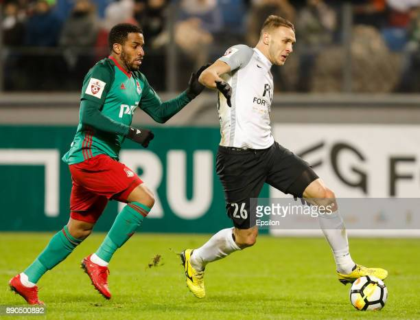 Rade Dugalic of FC Tosno and Jefferson Farfan of FC Lokomotiv Moscow vie for the ball during the Russian Football League match between FC Tosno and...