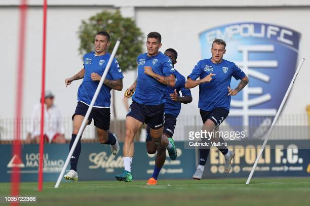 Rade Krunic Giovanni Di Lorenzo and Antonino La Gumina of Empoli FC in action during training session on September 18 2018 in Empoli Italy