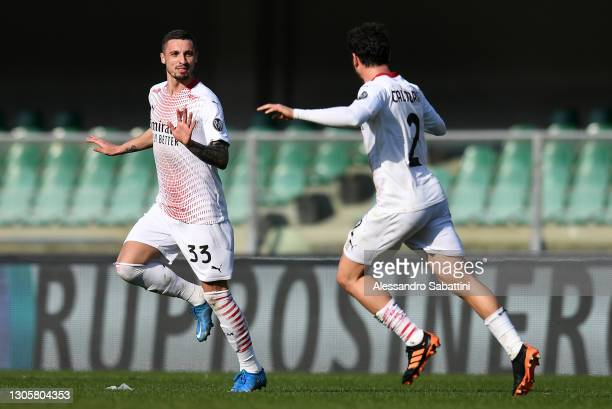 Rade Krunic of A.C. Milan celebrates with Davide Calabria after scoring their side's first goal during the Serie A match between Hellas Verona FC and...