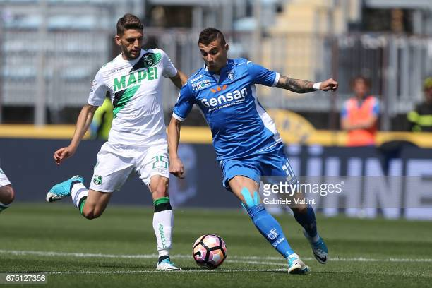 Rade Krunic of Empoli FC battles for the ball with Domenico Berardi of US Sassuolo during the Serie A match between Empoli FC and US Sassuolo at...